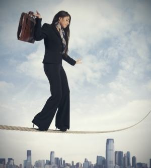Concept of risk in business with businesswoman on the rope.jpg
