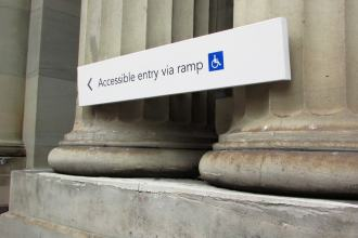 Old Melbourne Post Office, sign showing accessible ramp on Bourke Street