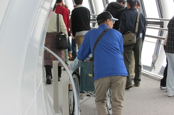 Tokyo Skytree Japanese tourist pushing their partner in a wheelchair around the observation deck
