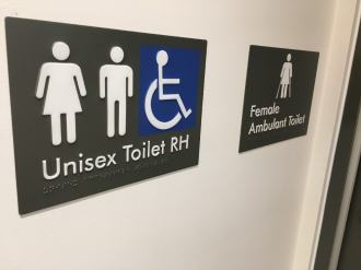 Braille and tactile RH unisex accessible toilet sign and a female ambulant toilet sign
