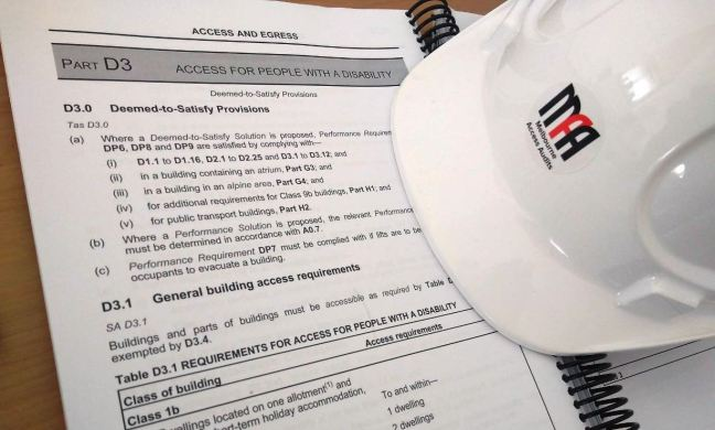 Construction Hard Hat with Melbourne Access Audits and Building Code open on Part D3 Access for People with Disability
